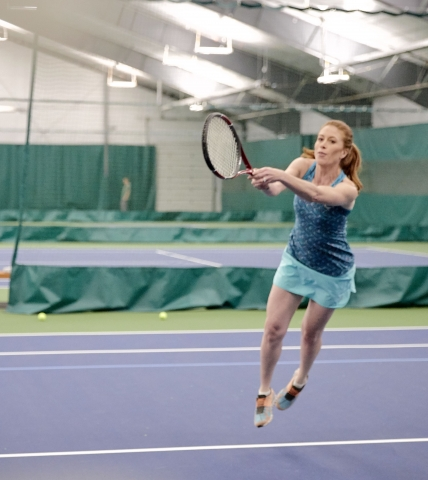 A girl playing tennis at Garden of the Gods Resort and Club