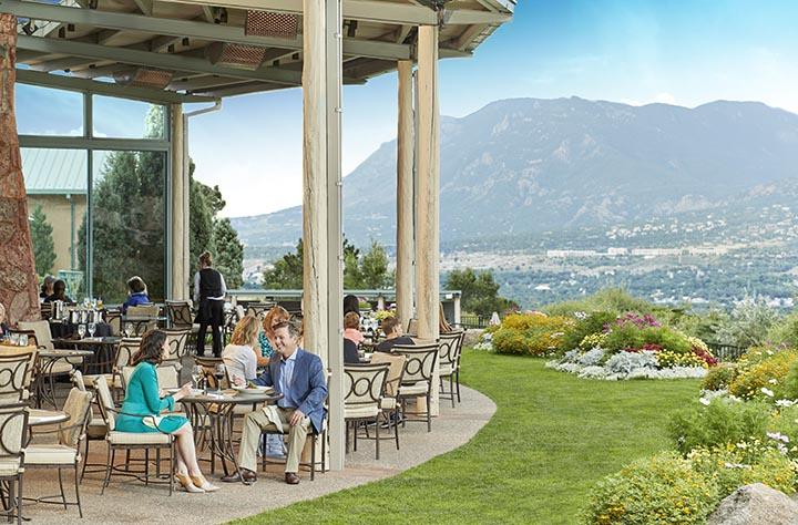 outdoor dining with mountains in the background