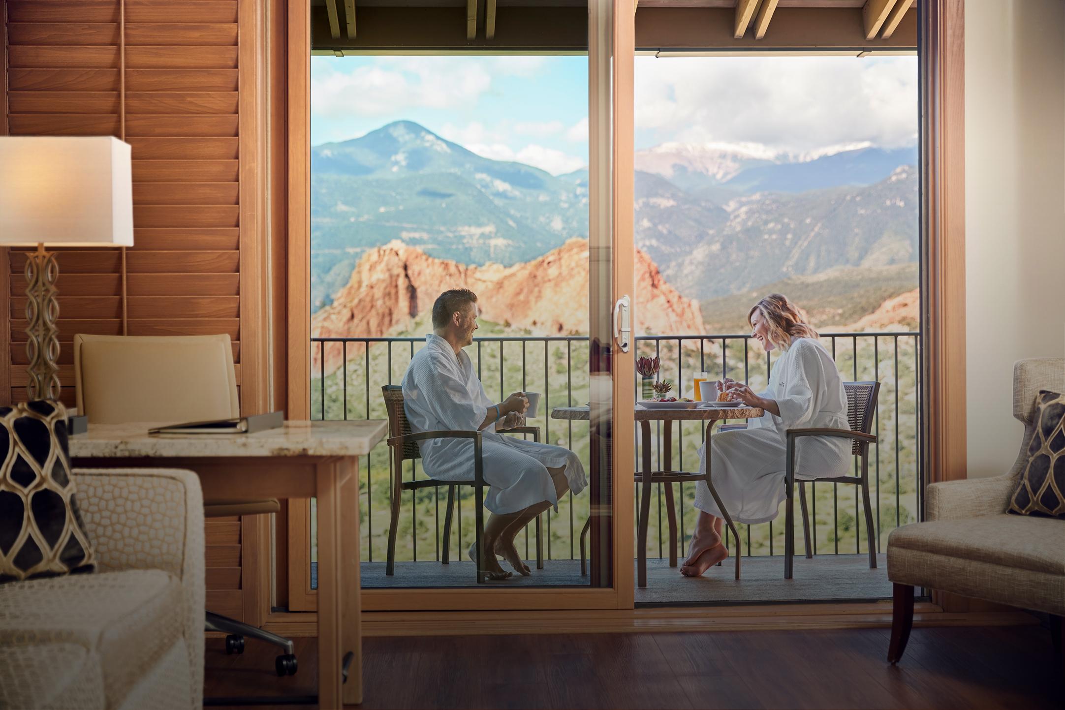 couple eating breakfast on the balcony