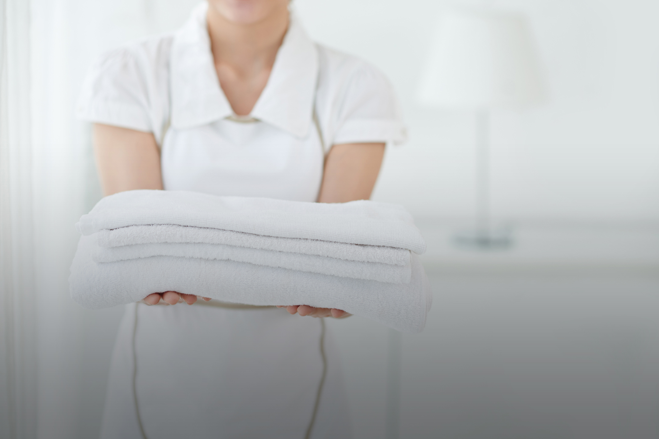 guest services holding towels