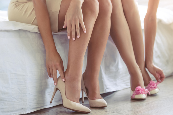 bridesmaids putting on heels