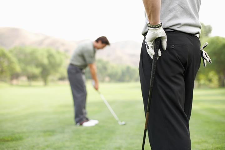 men golfing at performance program