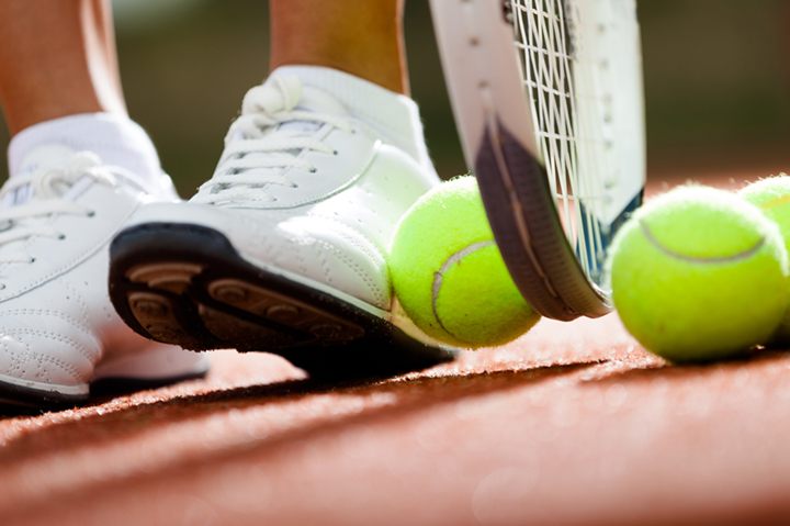 white shoes with tennis ball on court