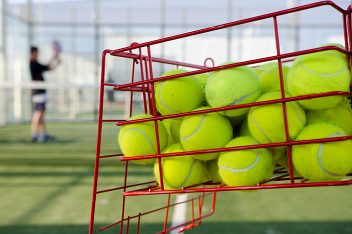 basket of tennis balls