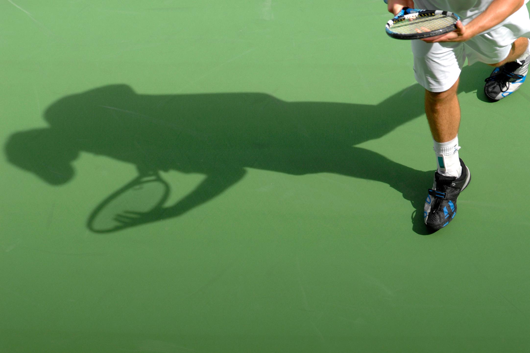 man on tennis court