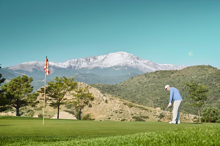 man golfing in spring