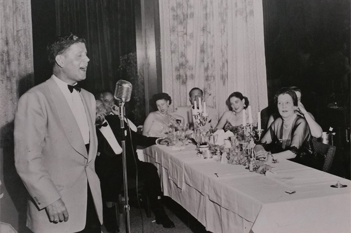historical man singing in a microphone