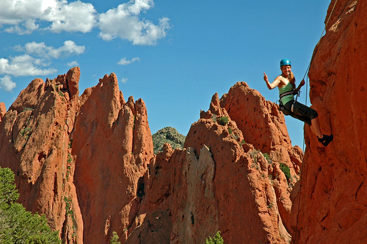 woman rock climbing garden of the gods
