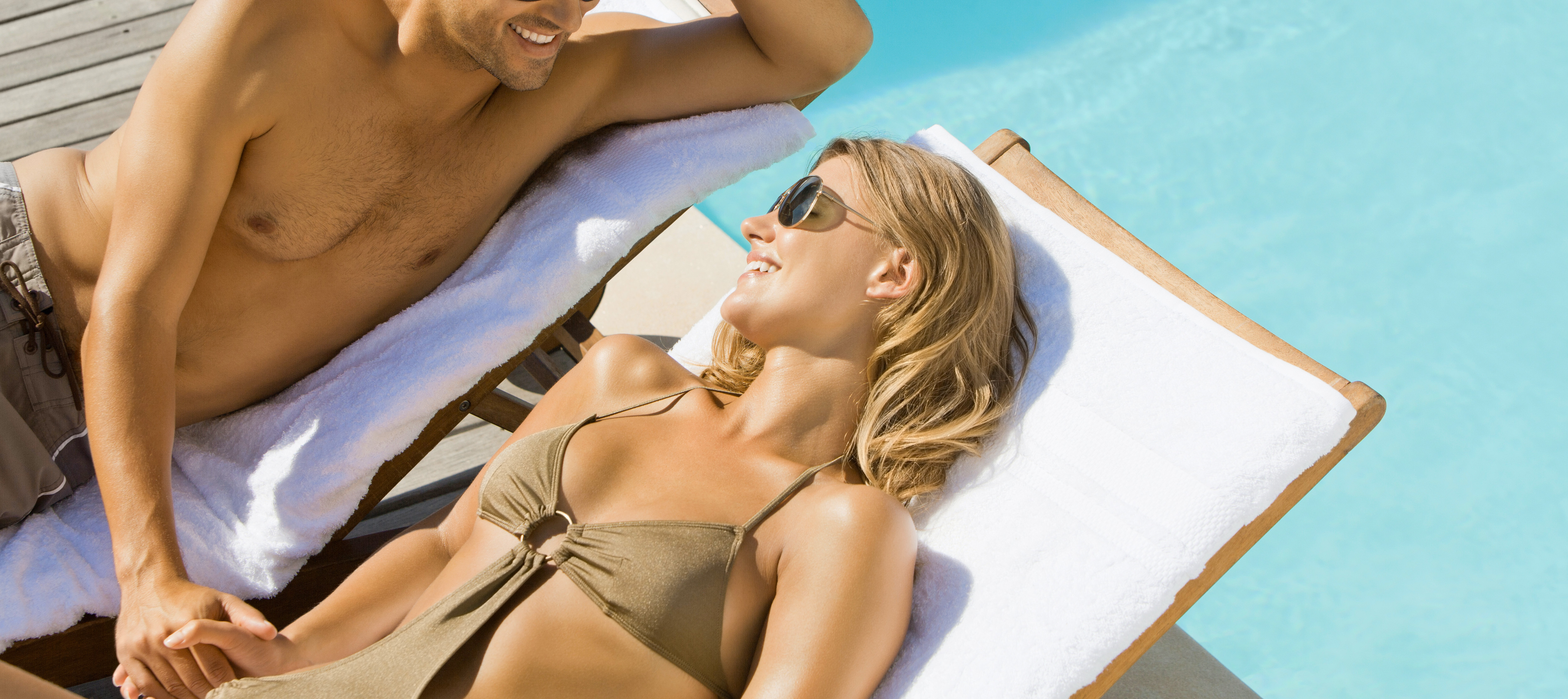 couple sitting at pool