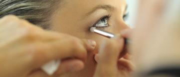 woman receiving eye makeup