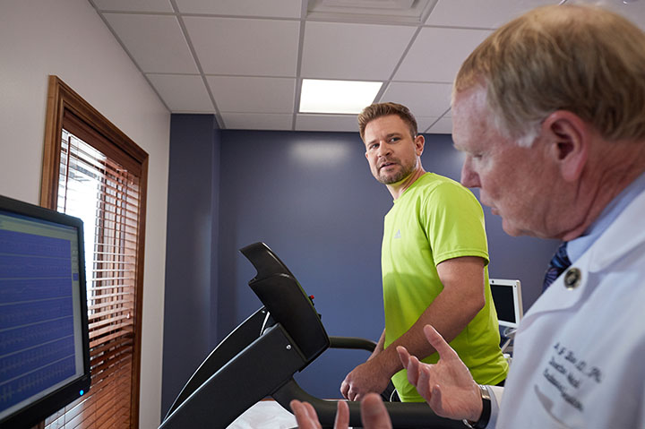 guy on treadmill with doctor