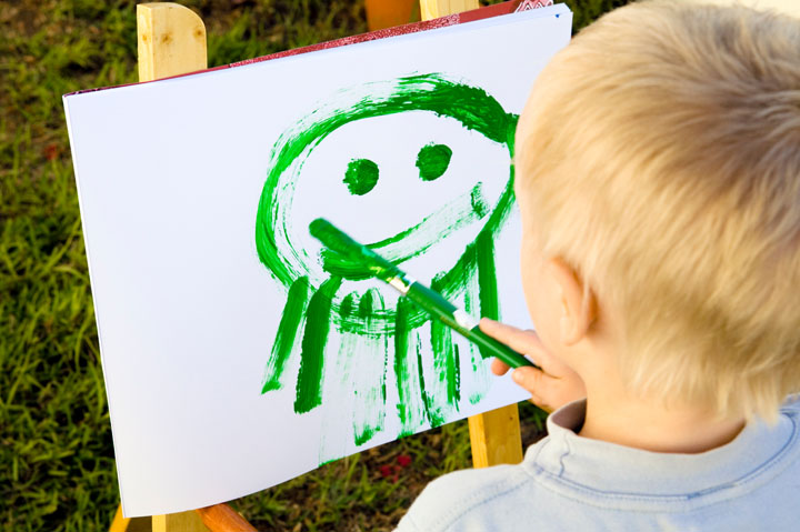 child painting outdoors