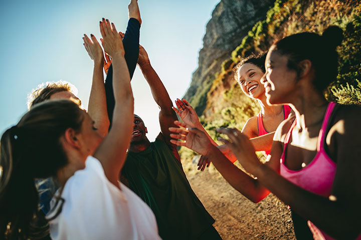group of people celebrating an outdoor exercise