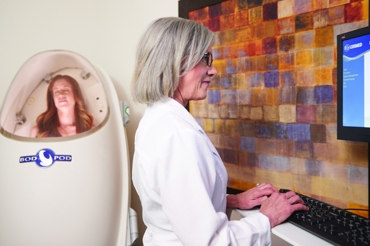 female in bod pod with doctor