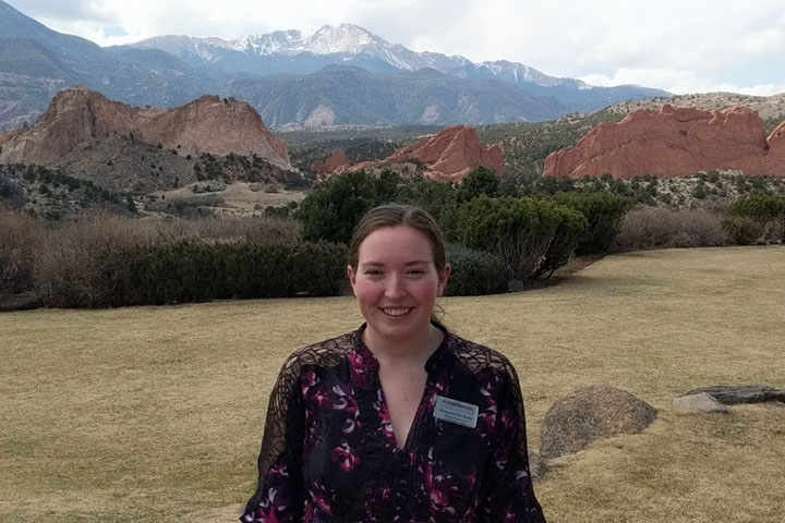 portrait of woman in front of garden of the gods mountains